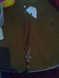 brown rope necklace with silver-colored cross pendant Winnipeg, R3B 2E3
