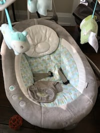 Gray and teal polka-dotted cradle and swing