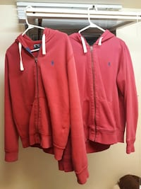 Two red polo hoodies