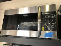 Over the range microwave stainless steel-4 months warranty  Baltimore, 21215