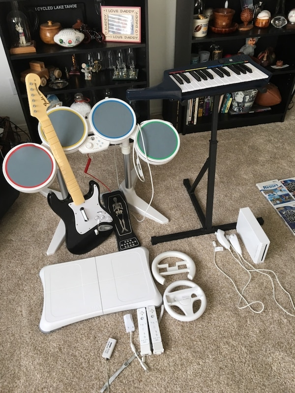Wii System With Rockband Set and 25 Games 49e2affd-f7f9-4821-aade-54becb229fd4