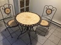 round black metal table with four chairs