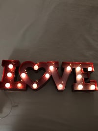 brown wooden love standing letter with lights
