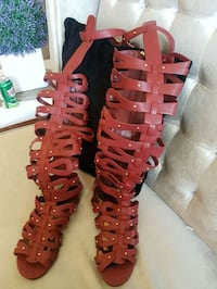 pair of red leather gladiator sandals 3148 km