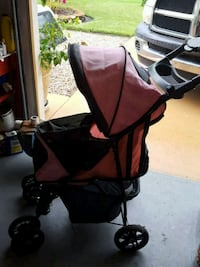 baby's black and orange stroller Palm Coast, 32137
