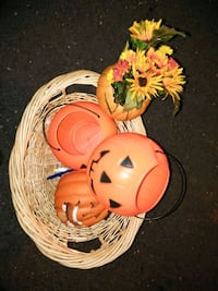 red Jack-o'-lantern buckets, brown wicker basket and yellow and red mums and sunflowers