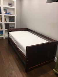 brown wooden bed frame with white mattress Toronto, M4M 2T6