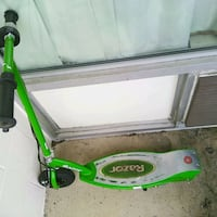 green and gray Razor brand electric scooter 54 km