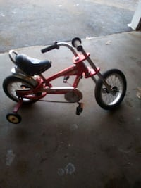 It's a kid's bicycle has training wheels in good condition