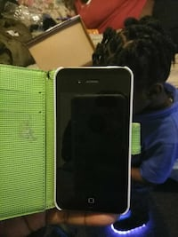black iPhone 4 with green and white flip case