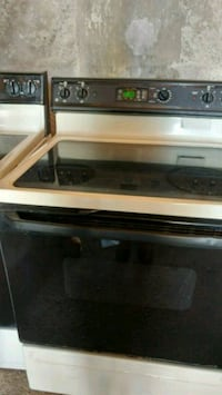 A glass top stove a Amana brand