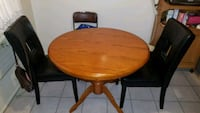 round brown wooden pedestal table Covina, 91724