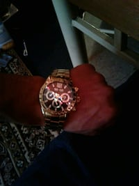 round gold divers watch with link bracelet