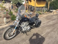 Black touring motorcycleblue sportster2sets of pipes2009   Firm.    It's blue