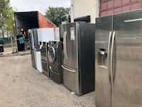 gray side-by-side refrigerator with dispenser 220 mi