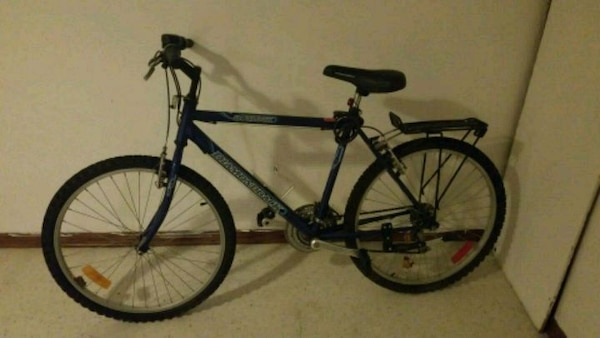 black and blue hard tail mountain bike