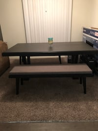 Rectangular Rooms to go black wooden dinning table NEW only 3 months of use