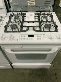 "GE 31"" SLIDE IN NATURAL GAS STOVE $279 #31714 Hempstead, 11550"