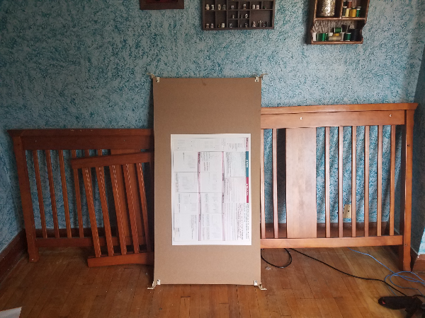 disassembled brown wooden crib