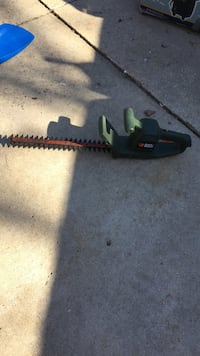 green and orange hedge trimmer