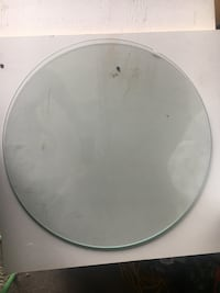 Round table clear glass with beveled edges. Diameter 21inches a very tiny damage see picture Mississauga, L4T 2K1