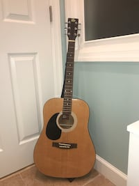 Brown and black wooden dreadnought acoustic guitar
