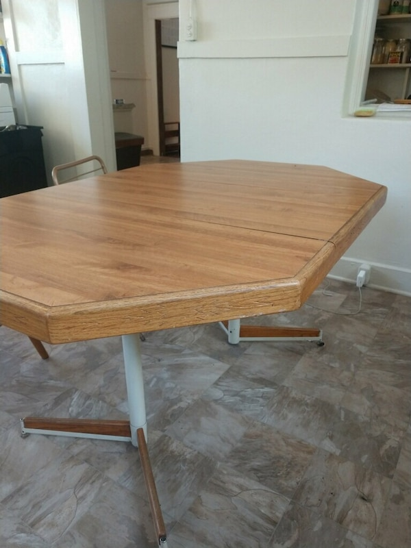 Good sized kitchen table with leaf and two chairs!