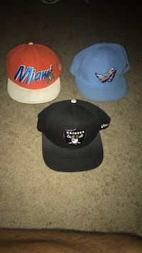 three black, blue, and yellow fitted caps Fresno, 93722