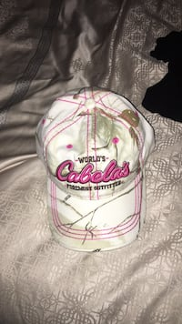 White and pink Cabelas baseball cap. Never worn Abbotsford, V4X 1J5