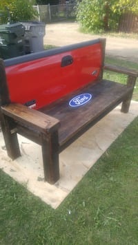 red and brown Ford bench