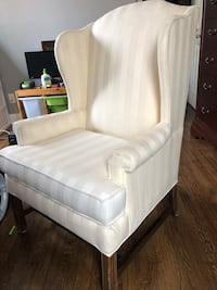 Cream-colored, padded chair with brown wooden frame Beltsville, 20705