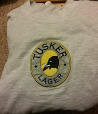 gray and yelow Tusker Lager crew-neck shirt
