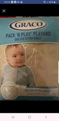 Never opened Graco quilted play yard sheet