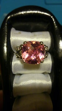 Pink and white colored gemstone ring.