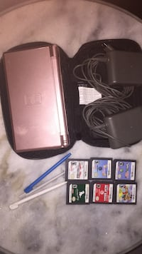 Rose gold ds with 6 games, 4 pens and case