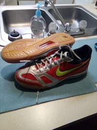 pair of red-and-black Nike running shoes size 11 Reynoldsburg, 43068