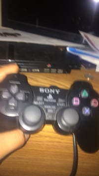 Black sony ps2 and game controller Oxnard, 93033