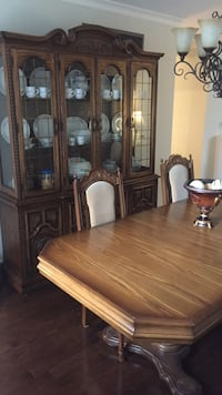 brown wooden dining set and brown wooden china cabinet