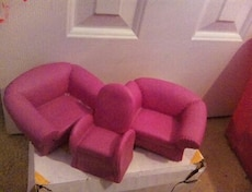 three pink leather sofa chairs