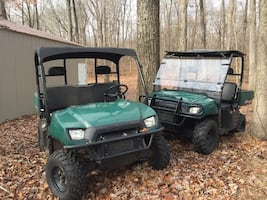Two Polaris Rangers a 2005 and a 2006 with extra tires and rims.