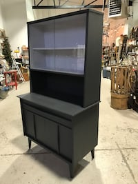 black wooden TV hutch with flat screen television London, N6B 1L7
