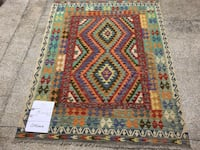 brown, red, and green area rug