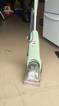white and green upright vacuum cleaner Port Richey, 34668