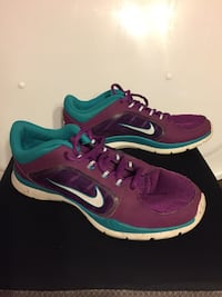 Pair of purple-and-teal Nike shoes Crystal River, 34428