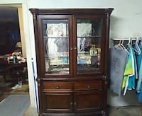 brown wooden framed glass display cabinet Topeka, 66605