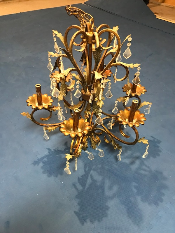 gold-colored and white uplight chandelier