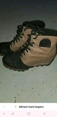 pair of brown leather work boots Toronto, M6K 3S2