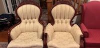 two brown wooden framed white padded armchairs 27 km
