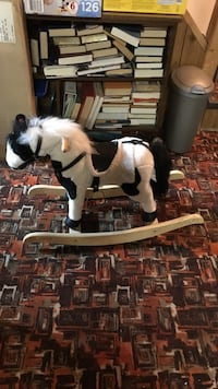 White and black rocking horse