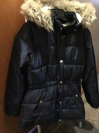 Dark blue zip-up bubble jacket. Good condition
